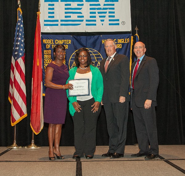 At the chapter's annual Education Foundation luncheon in May, Qwenshana King (2nd from l) receives an Education for Industry scholarship from Charisse Stokes (l), director of the chapter's Education Foundation, alongside AFCEA President and CEO Lt. Gen. Robert M. Shea, USMC (Ret.) (2nd from r), and Robert Shofner, program executive officer for Business and Enterprise Systems, Maxwell Air Force Base, Gunter Annex, Alabama.