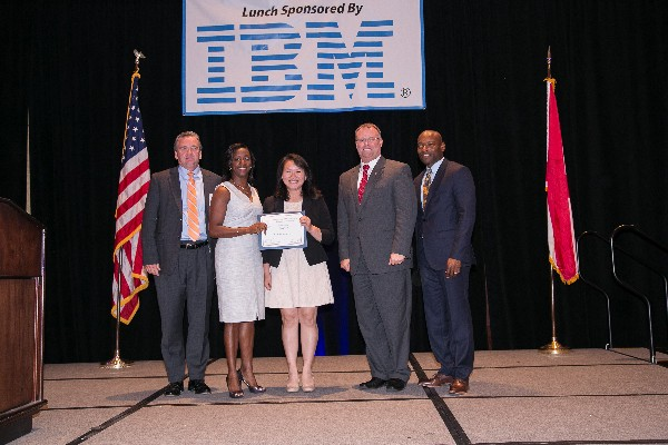 Recognizing Jade Teel (c), a scholarship recipient from Loveless Academic Magnet Program in Montgomery, Alabama, at the May Education Foundation luncheon are (l-r) Brian Knott of Array; Charisse Stokes, director of the chapter's Education Foundation; Richard Aldridge, program executive officer for Business and Enterprise Systems, Maxwell Air Force Base, Gunter Annex, Alabama; and Eric Sloan, chapter president.