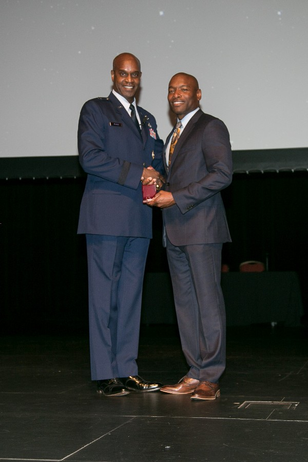 Brig. Gen. Cedric George (l), USAF, deputy director of resource integration, deputy chief of staff for logistics, engineering and force protection, receives a token of appreciation from Chapter President Eric Sloan at the annual Montgomery Information Technology Summit (MITS) in May.
