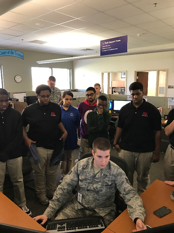 During the chapter's March Job Shadow Day, a U.S. Air Force staff sergeant (front, c) shows Robert E. Lee High School students how to remotely shut down a computer.