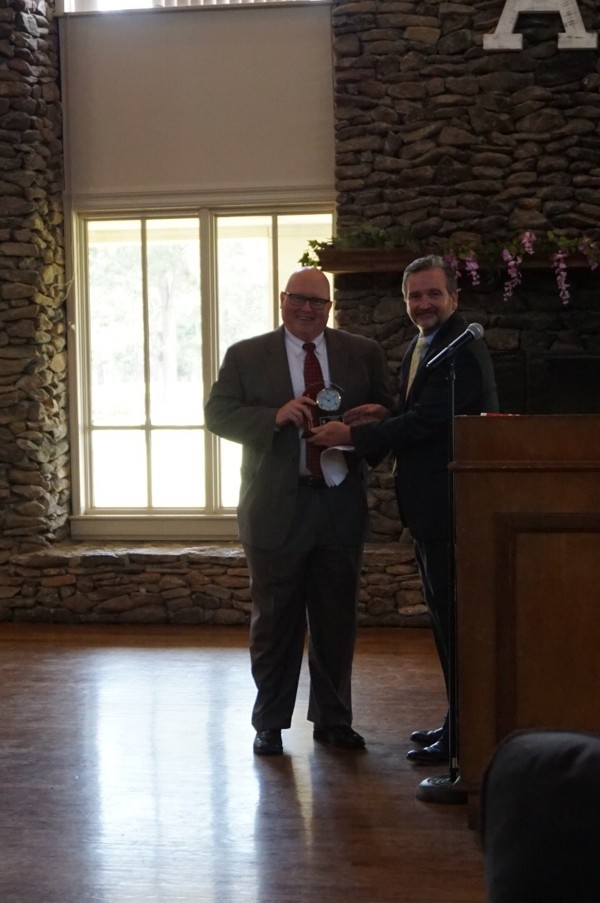 Joseph Sifer, AFCEA International's chairman of the board, receives a token of the chapter's appreciation from Brian Knott, president, for speaking at the April luncheon.