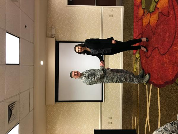 Young AFCEAN Tija Brown presents Maj. Kevin Deibler, USAF, commander, 689th Network Operations Squadron, a token of appreciation for speaking at the chapter's January breakfast.