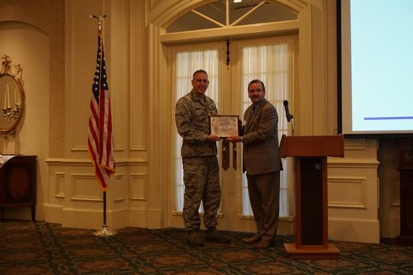 Chapter President Brian Knott (r) presents Col. Kyle Reybitz, USAF, deputy program executive officer (PEO) for Business and Enterprise Systems (BES), with a token of appreciation for speaking at the chapter's January meeting.