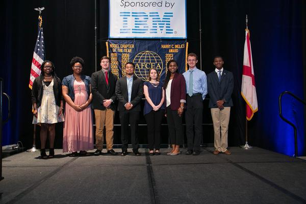 Accepting chapter scholarships at the chapter's May Education Foundation luncheon are (l-r) Asia Mitchell, Nyaesia Thompson, John Scott Dennis, Luis Sarmiento, Emily Cosgrove, Kaela Williams, Henry Petters and Harris Washington.