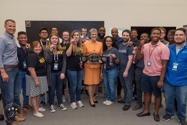 InnovateAFITC winners and staff members display the grand prize and event challenge medals from the August cyber and STEM competition, co-sponsored by the chapter.