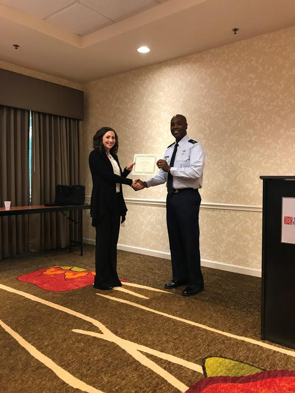 Tija Brown, the chapter's Young AFCEAN president, presents Col. Alvin Burse, USAF, senior materiel leader/system program manager (SPM), and chief, Air Force Legacy Logistics Sustainment Division, with a certificate of the chapter's appreciation at the September breakfast.