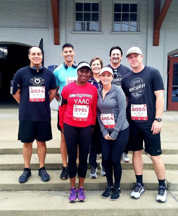 The Young AFCEAN Advisory Council (YAAC) 5K team poses before the start of the Enlisted Heritage Hall 5K in March.