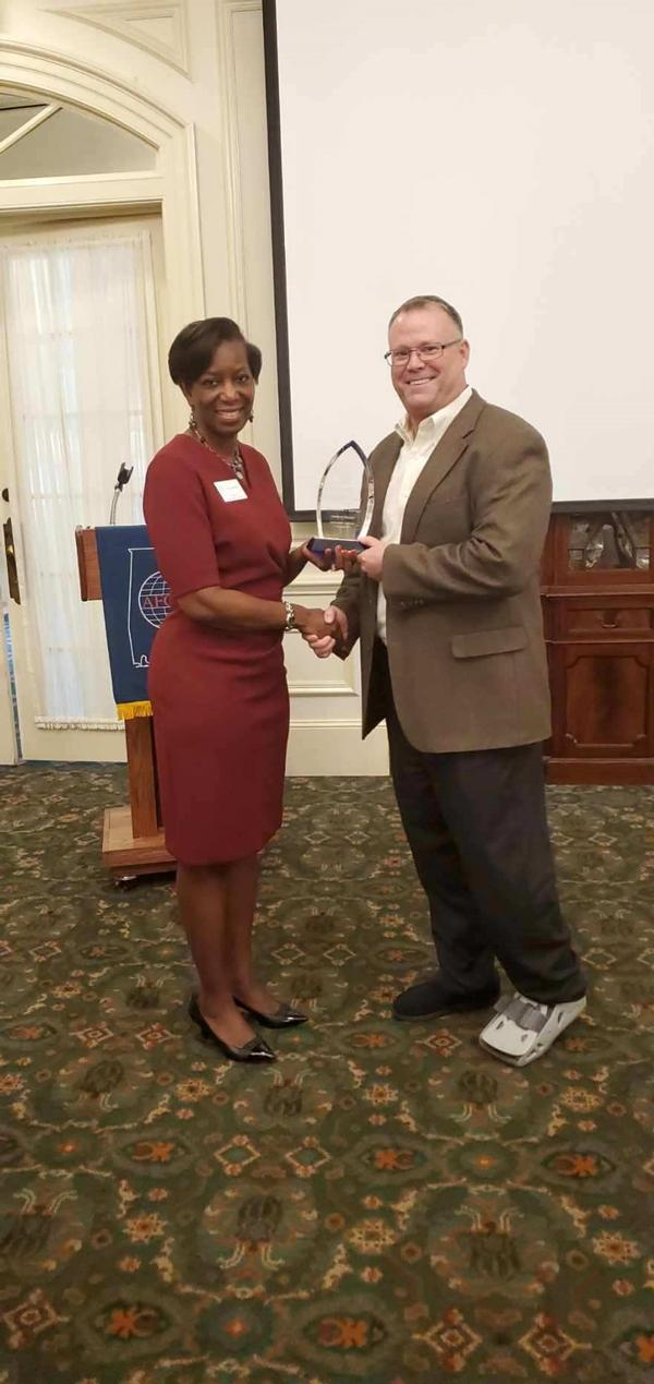 Col. Kyna Paster, USAF (Ret.), chapter president, presents Richard Aldridge, program executive officer (PEO) for Business and Enterprise Systems (BES) with a token of the chapter's appreciation for speaking at the November luncheon.