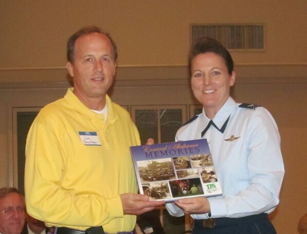 Dr. Joseph Besselman, chapter president, presents a welcoming gift to Col. Tammy M. Knierim, USAF, director education operations and information, headquarters, Air University, Maxwell Air Force Base, at the October meeting.
