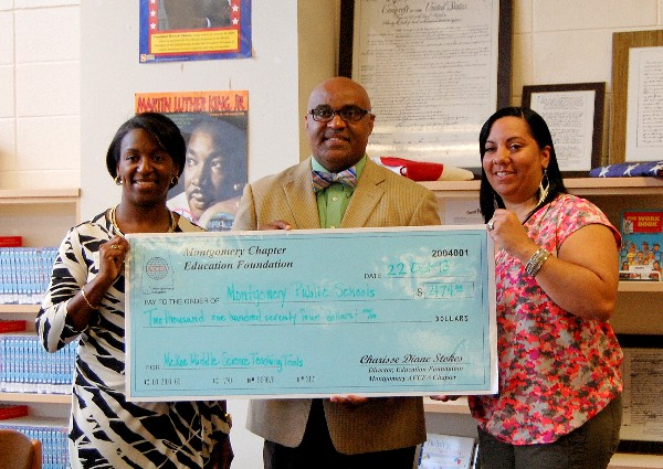 Charisse Stokes (l), director, chapter Education Foundation, presents Patrick Nelson (c), principal, McKee Middle School, and Monica Jackson, science instructor and seventh grade Science Department chair, with a Science Teaching Tools Award in October.
