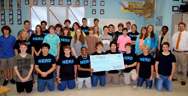 In October, Wetumpka High School's Robotics Team accepts a $5,000 donation from the chapter Education Foundation presented by Charisse Stokes (middle row, 2nd from r), director, Education Foundation. Dr. Virginia Vilardi (middle row, 2nd from l), program director, mentioned the team is excited to use the funds to support essential computer and software upgrades in preparation for an upcoming competition.