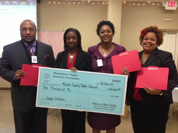 In November, Dr. Melvin A. Lowe III, education coordinator for Macon County Schools, along with Jacqueline A. Brooks (2nd from r), Macon County superintendent, and Camille Floyd (r), instructor, accept a Chapter Initiative Grant for $10,000 from Charisse Stokes, director, chapter Education Foundation.