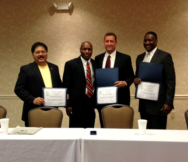 At the May meeting, Eric Sloan (2nd from l), president of the chapter�s Young AFCEAN Advisory Council, presents certificates of appreciation to guest speakers Bill Woodhouse (l), chief executive officer (CEO), eSolution Architects, Incorporated; Steve Goldsby (2nd from r), CEO, Integrated Computer Solutions; and Josh Bush, CEO, Up and Running Incorporated.