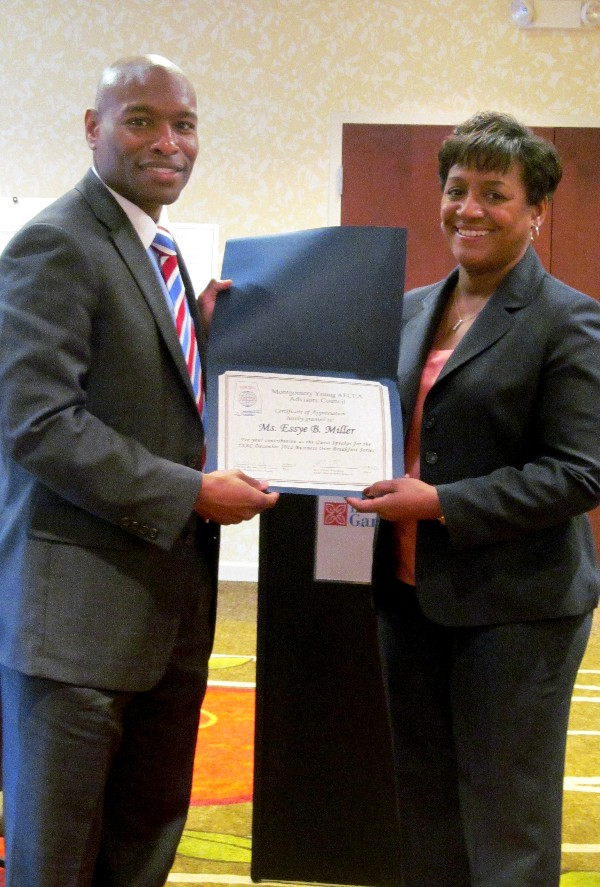 Eric Sloan (l), president of the chapter�s Young AFCEANs, presents a certificate of appreciation to Essye Miller for her dynamic presentation at the December Business Over Breakfast event.