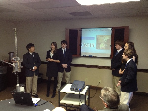 Members of the Wetumpka High School Robotics Team present their ideas to chapter and Montgomery Industry Partners members in November.