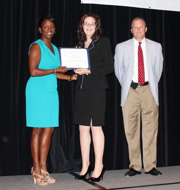 In June, Kaitlan Cooper (c), a rising senior at Auburn University Montgomery, accepts her Education for Industry Scholarship from Stokes and Besselman.