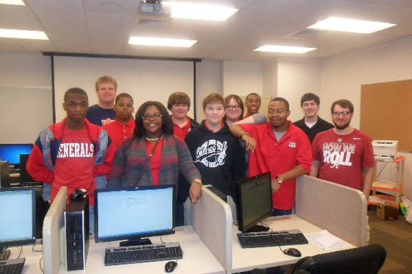 IT Academy students take a break for a smile during the CyberPatriot Competition. The IT Academy teams both did well in the November qualifiers and advanced to round two of competition.