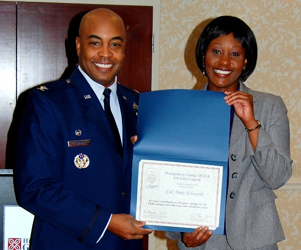 Kameke Mitchell (r), president, Young AFCEA Montgomery Chapter, presents Col. Edwards with a certificate of appreciation in January.