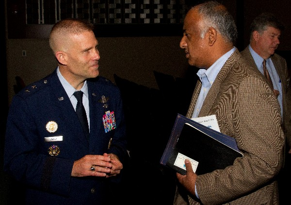 Maj. Gen. Steven Kwast, USAF, commander, Curtis E. Lemay Center for Doctrine Development and Education and vice commander, Air University (l), networks with an attendee after his presentation during MITS 2014 in May.