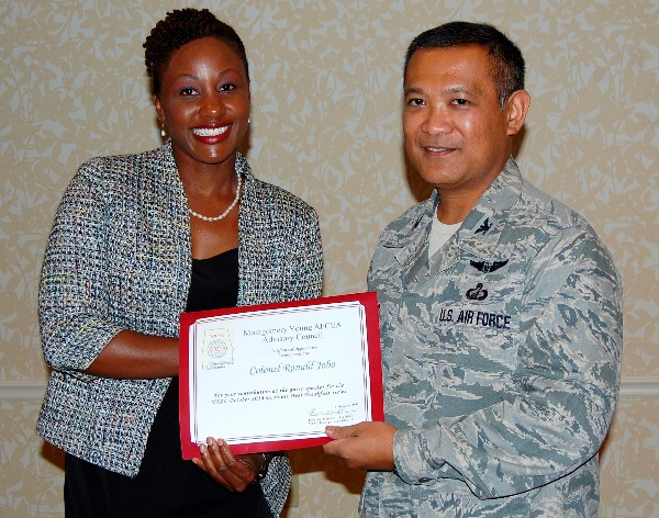 Kameke Mitchell, YAAC Montgomery president (l), presents Col. Jobo with a certificate of appreciation for speaking at October's Business Over Breakfast event.