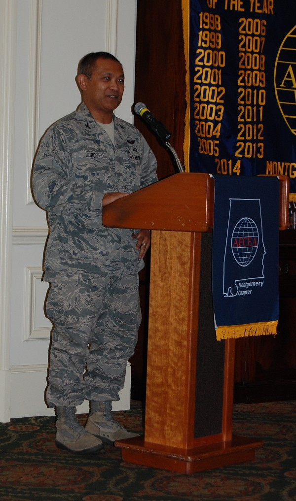Col. Ronald Jobo, USAF, deputy program executive officer, Business and Enterprise Systems, speaks to luncheon attendees in December.
