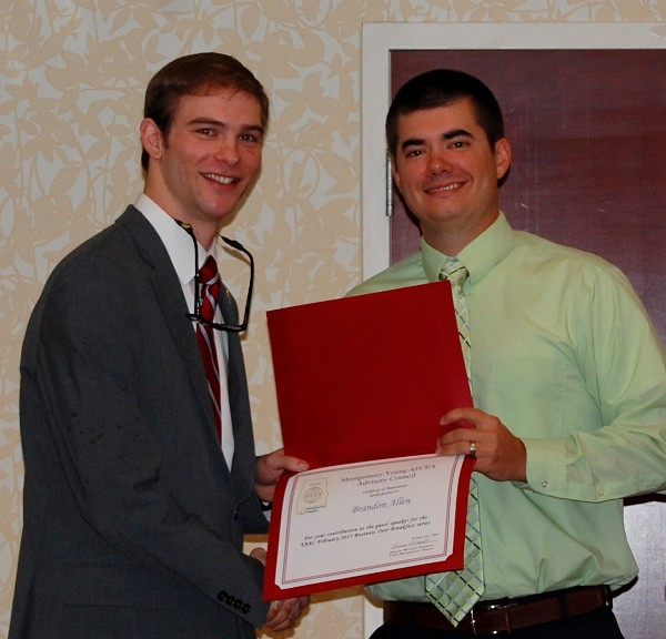 Allen (l) accepts a certificate of appreciation from Adam Vencill of the Montgomery Chapter at the February event.
