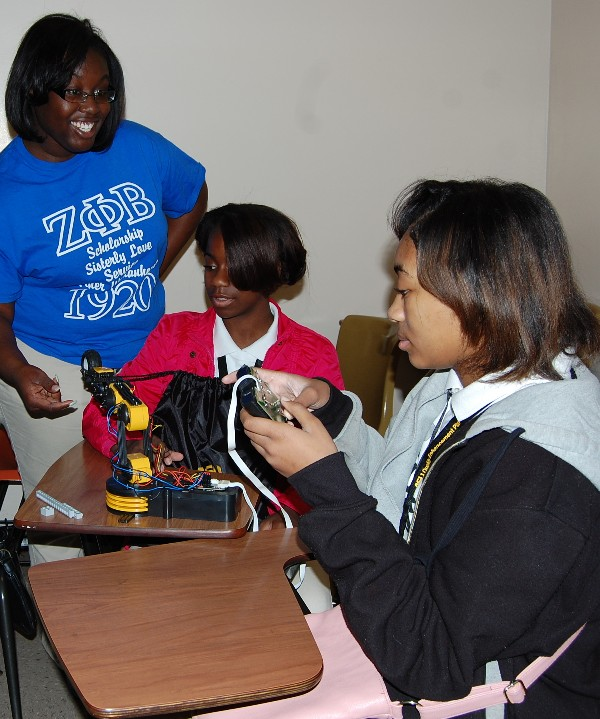 Students enjoy working together during a robotics mini-session at Camp IT in February.