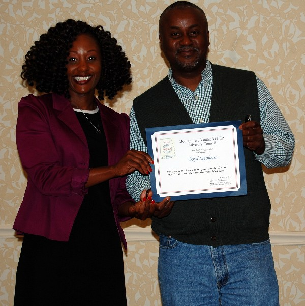 During the June breakfast, Stephens (r) accepts a certificate of appreciation from Kameke Mitchell, president, Young AFCEA Montgomery Chapter.