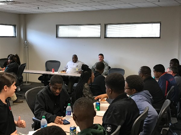 Herbert Hunter, director of staff, Business Enterprise Systems (BES) (c, l), and Col. Michael Jiru, USAF, deputy director of BES (c, r), talk to students at lunch during Job Shadow Day.