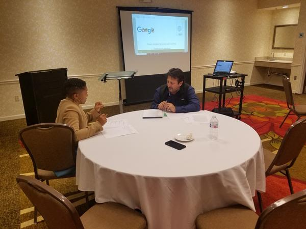 A workshop attendee engages in a one-on-one session with a resume counselor at the February event.