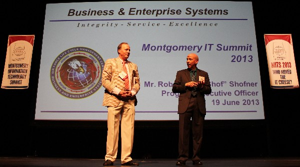 Besselman (l) introduces speaker Robert �Shof� Shofner, who spoke to MITS attendees regarding �Setting the Integration Stage� in June.