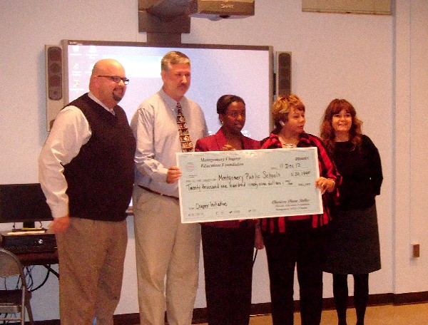 Accepting a $20,199 Chapter Initiative Grant from Stokes (c) in November are (l-r) Rod Sellers, Dunbar-Ramer School principal; Steve Blair, district technology instructor; Barbara Thompson, Montgomery Public Schools superintendent; and Debbie Webster, Goodwyn Middle School principal.
