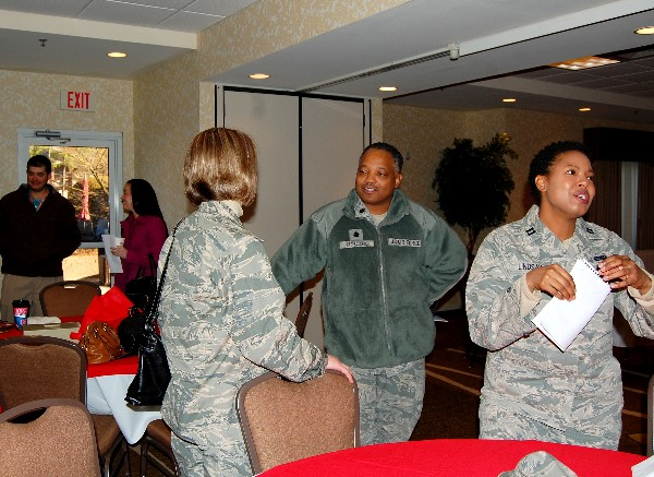 Various military and industry personnel network after the Business Over Breakfast seminar in January.