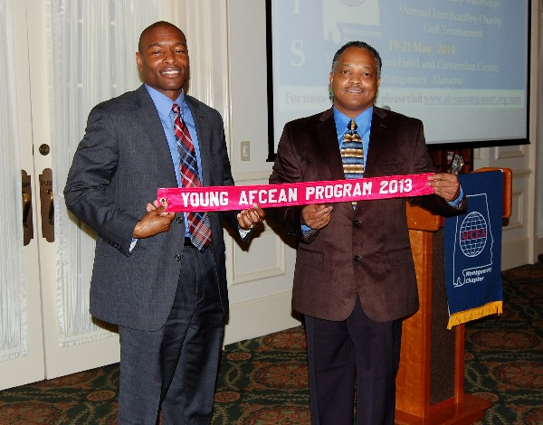 In February, Eric Sloan (l), chapter vice president, and Lt. Col. Leonard Boothe, USAF (r), chapter president, proudly display the chapter�s Model Young AFCEAN Program ribbon.