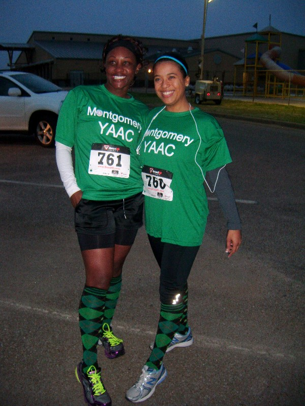 Kameke Mitchell (l), president of the chapter�s Young AFCEAN Advisory Council, and Capt. Seabrook-Hennessey smile before running the half marathon in March.