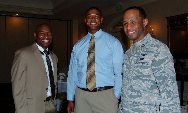 Chapter members Eric Sloan (l), Jesse Roberson (c) and Capt. Rashim McKinney, USAF, network during the December luncheon.