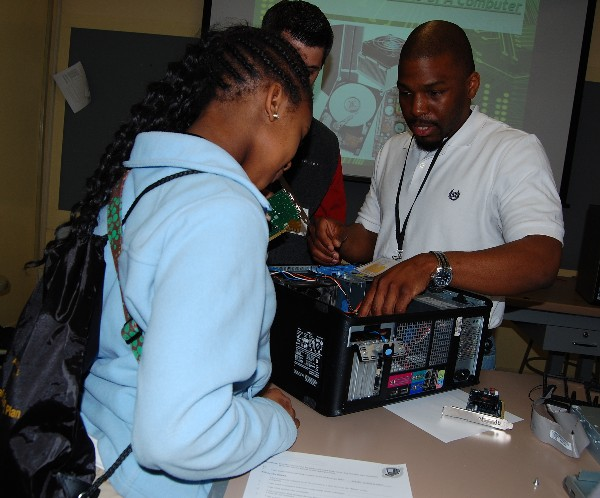 Students get hands-on interaction with computers during a mini-session on PC assembly at Camp IT in February.