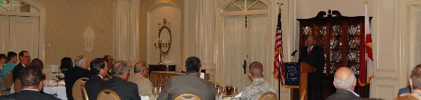 Gen. Peterson speaks to luncheon attendees in August.