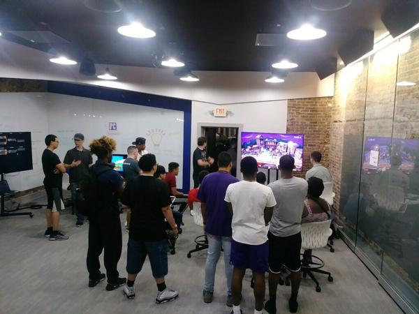 Players gather to watch teams compete at Super Smash Brothers during the May esports event.