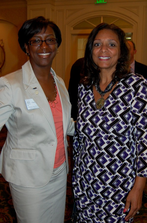 Charisse Stokes, director of the chapter's Education Foundation, and Deb Foster take a minute to greet each other after the presentation in April.