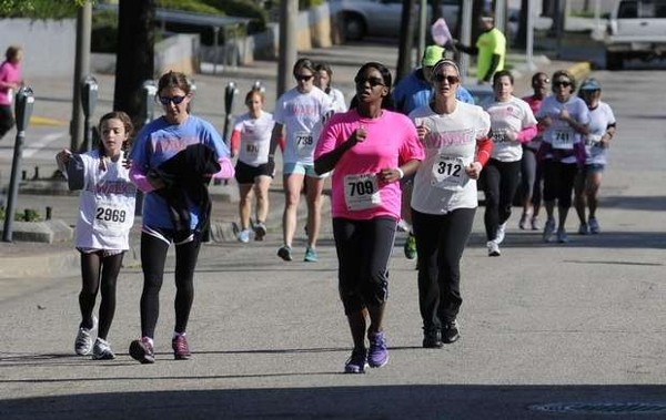 In April, Kameke Mitchell, chapter Young AFCEA Advisory Council member, crosses the finish line at the Walk of Life 5K.