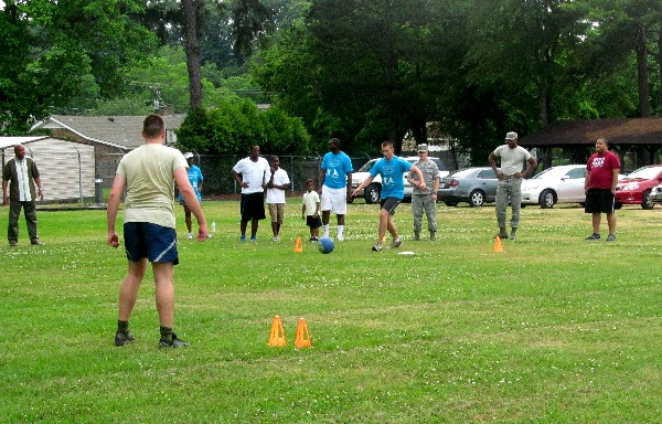 In May, Young AFCEANs take the field for kickball during a networking activity day.