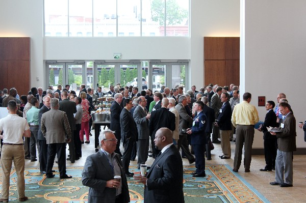 MITS 2013 conference attendees network during a break between speaker presentations at the June event.