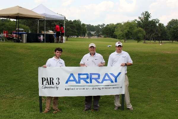 Members of Array Information Technology display signage and prepare to network during the Tom Brantley Annual Charity Golf Tournament. Array was a master level sponsor, donating a total of $7,500 to the Education Foundation via sponsorships. The company's recent AFCEA Information Technology Internship Program participant, Taylor Hopper (far l), assisted Array during the event, and received an invaluable opportunity to network with representatives from over 50 different companies, as well as members of government and the military.