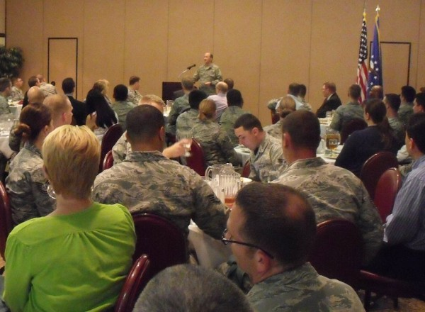 Col. Patrick Flood, USAF, the 548th Intelligence Surveillance and Reconnaissance Group commander, addresses a packed house at Beale Air Force Base during the chapter's April luncheon.