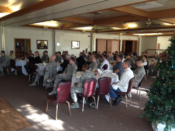 Luncheon attendees gather at Travis Air Force Base in December to hear a presentation on information technology design.