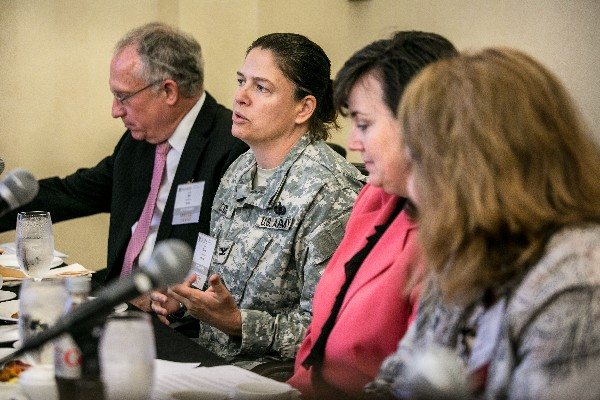 Col. Claire Cuccio, USA, Office of the Secretary of Defense for Acquisition, Technology and Logistics, addresses attendees at the August Women in NOVA event.