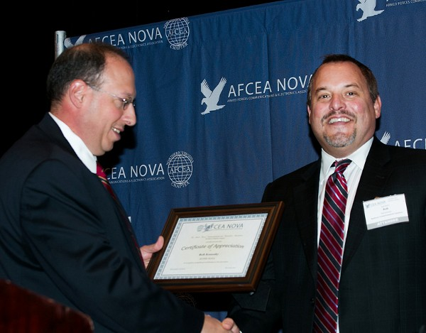 Chris Cusano (l), chapter president, presents the November SuperNOVA Award to Rob Konosky, Raytheon Trusted Computing Systems.