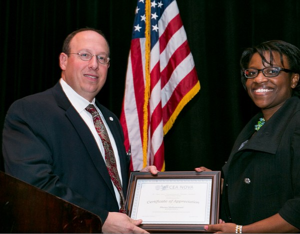 In December, Shana Muhammad, Strategic Resources Incorporated, accepts the chapter�s SuperNOVA Award from Cusano.