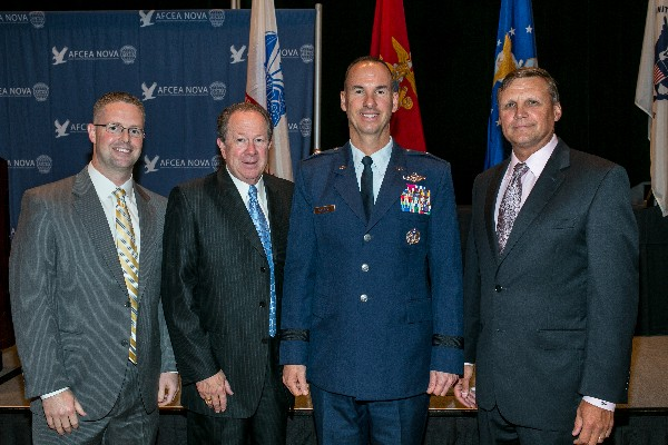 Together at the October luncheon are (l-r) Rob Lehman, recipient of the Young AFCEAN Award; Don Carmichael, recipient of the Super NOVA Award; Gen. Killough; and Ron Zich, chapter president.